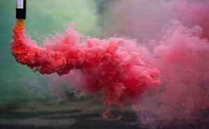 coloroful pink smoke bombs in action